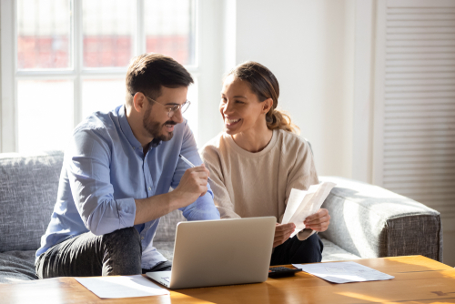Couple applying for an online loan from their couch